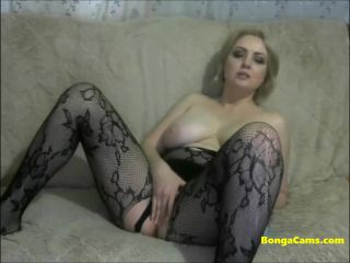 eous blonde milf in black tights uses a big dildo
