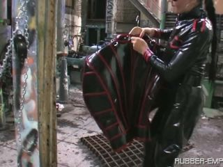 Bondage Male – Rubber Empire – Trapped in a Rubber Jail – The Baroness
