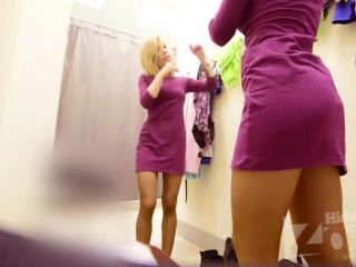 Nice busty blonde girl with shaved pussy in the changing room. spy cam