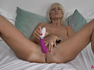 Old_blonde_mom_plays_with_her_pussy
