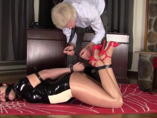Paige Erin Turner – Leather Hogtied in Latex