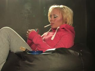 Terri Hawkes Relaxes In Joggers Hoodie Smoking Strong Cork Cigarettes