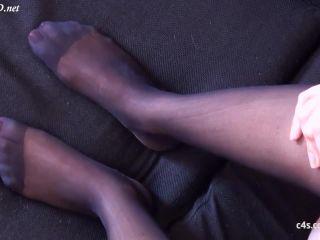 SECRET FOOTJOBS presents Andrea gives sexy pantyhose footjob!