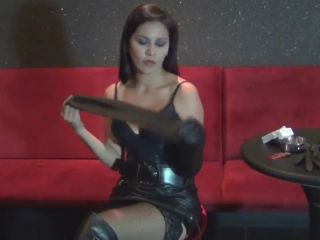 Smoking girl in black boots and slave