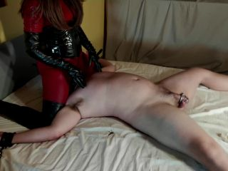 Cruel Leather Mistress in Catsuit