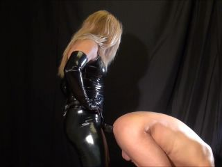 Madam M in action with her big black strap-on