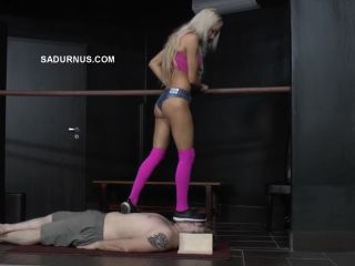 Face stomp – Ariel stands on his face