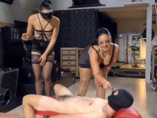 Face Sitting – Mistress Ezada Sinn – Chaste ass-cushion for two Dommes in lingerie – Mistress Gaia and Mistress Ezada Sinn