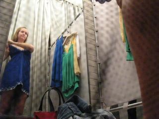 Cute blonde girl in the fitting room. hidden cam