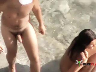 Latin Couple having sex on the beach.