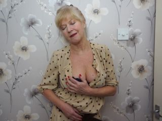 British housewife playing Emily Jane with her toy