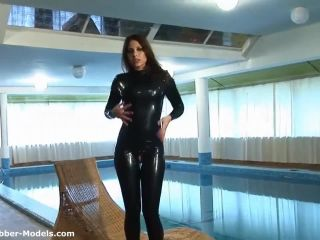 Flexible Sexy Woman in Latex Catsuit with her Sexy Pussy