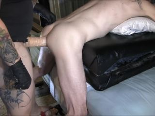 Dominant milf gives her boy a hard pegging with a strapon and fists P ...