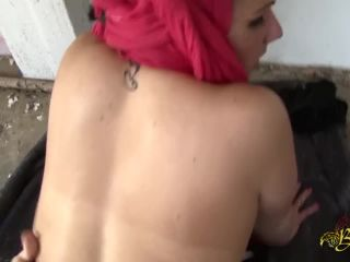 A Muslim woman in hijab in an abandoned house -