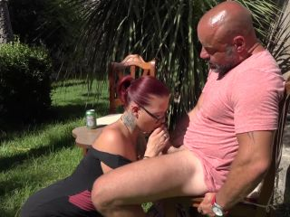 Pierced milf and redhead tattooed babe are sharing a cock outdoors