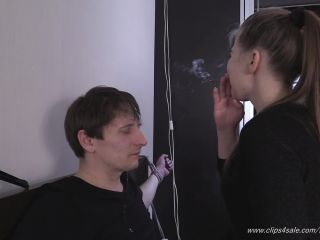 Beautiful Girls – Sitting In Front Of Her Pathetic Male Slave, She Smokes A Cigarette And Blows Smoke In His Face