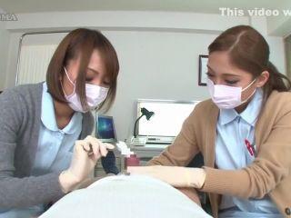 2 nurses in latex gloves teasing patient