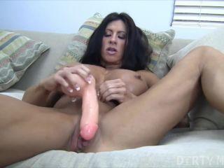 Hot brunette muscle girl dildoing her pussy