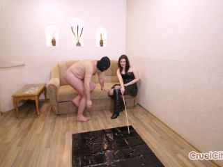 Cruel City  Mistress Olivia Tortures Her Slave with Hot Wax. Starring Mistress Olivia