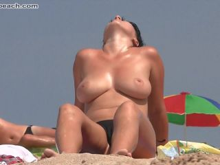 Nude, beach, young girl shows big tits, boobs