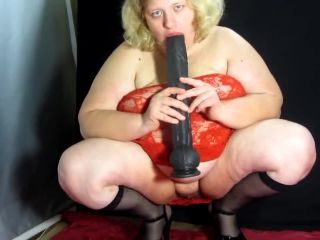 Mature Russian fatty fucks herself with a huge dildo