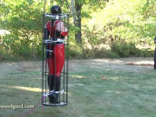 Latex bondage doll jewell caged and stored in silo