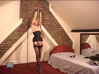 Suspended Blonde Slave