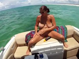 Exhibitionist wife with massive tits naked on a boat