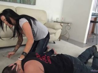 Austin Lynn, barefoot in jeans is trampling and humiliating her slave ...