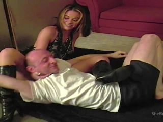 Realsexpass.com- Booted brunette wrestling and facesitting