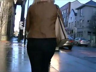 Following a classy woman's ass