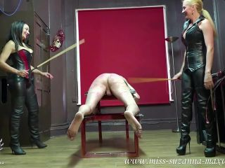 Miss Suzanna Maxwell A Leather Clad Double Caning