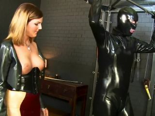Latex Domme Punishes her Gimp