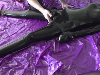 Latex catsuit bondage of rubber doll