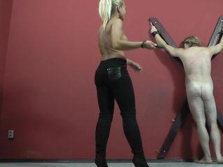 Blond – CRUEL MISTRESSES – Half naked mistress with a whip – Mistress Gitta