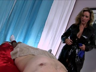 Jodi West in Mistress Jodi Milks A Restrained Young Man With Latex Gloves