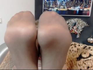 Mature woman shows stinky nylon feet on webcam