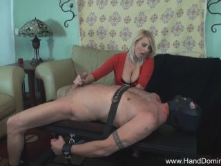 Milf beats victim with his own cock during femdom handjob