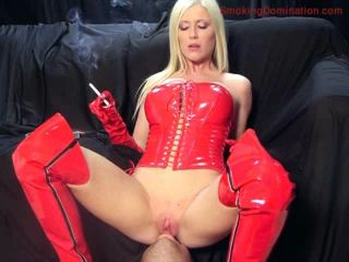 Movie title Mistress Michelle B blows her smoke into male slaves face