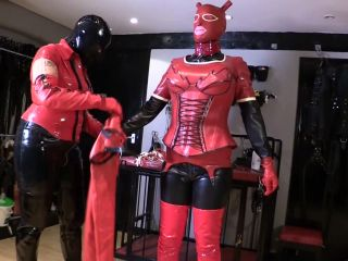 Female Domination – The Bondage Mistress Club – Mistress Rouge in Rubber Dressing Finale
