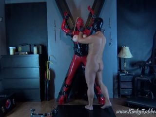 Latex Porn – 7613 – Ballgagged And Teased On The Cross