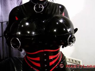 Nasty shemale Lara in latex suite fist and cum on herself