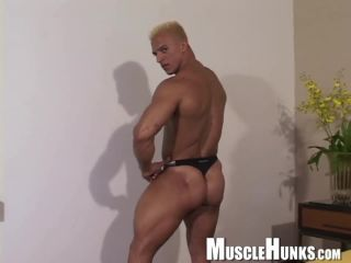 Beefy bodybuilder flexes
