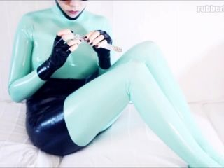 Weekend activity in jade latex catsuit and black latex accessories