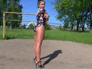 nice teen in suntan shiny pantyhose leotard