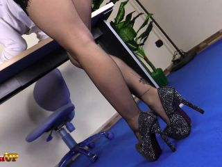Candid secretary and female... - C 110 Young blond secretary shoeplaying with black high heels and white pantyhose