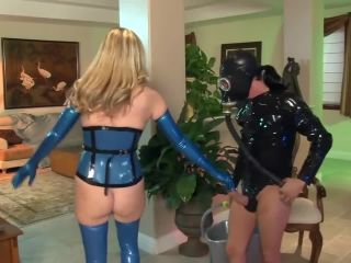 Bossy blonde fucked on a couch in latex gloves a corset and stockings