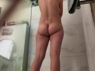 Busty wife with hairy pussy shaving legs in the shower. hidden cam