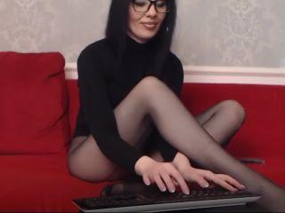 sexy amateur brunette posing in black back seamed pantyhose