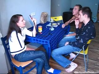 Two young couples fuck on a kitchen table